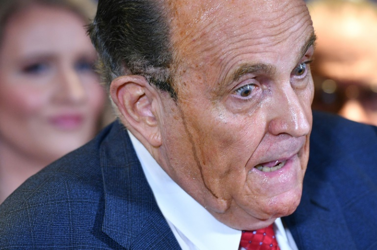 Trump's personal lawyer Rudy Giuliani sweats, and hair dye runs down his face, during a press conference at the Republican National Committee headquarters in Washington, DC. (Photo: AFP)