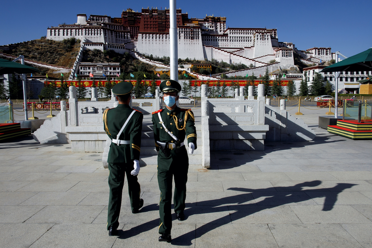 Paramilitary police officers take part in a change of the guard in front of the Potala Palace in Lhasa, during a Chinese government-organised media tour of the Tibet Autonomous Region on Oct 15. (Reuters Photo)