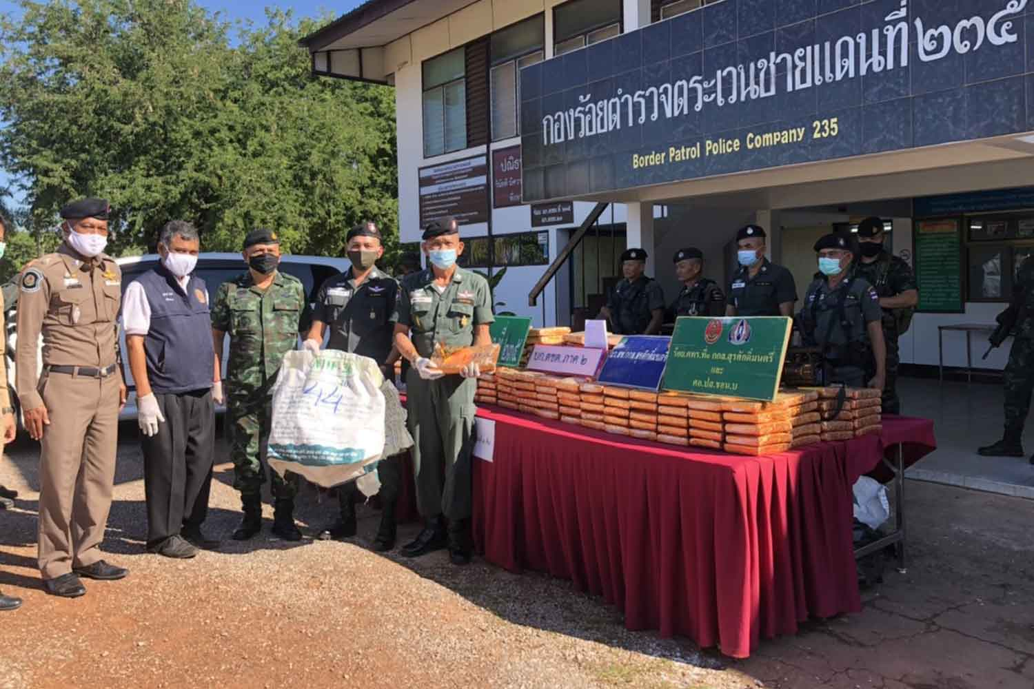 Slabs of dried marijuana are put on display for a press briefing at Border Patrol Police Company 235 in Nakhon Phanom province. The drugs were seized on Saturday night. (Photo by Pattanapong Sripiachai)