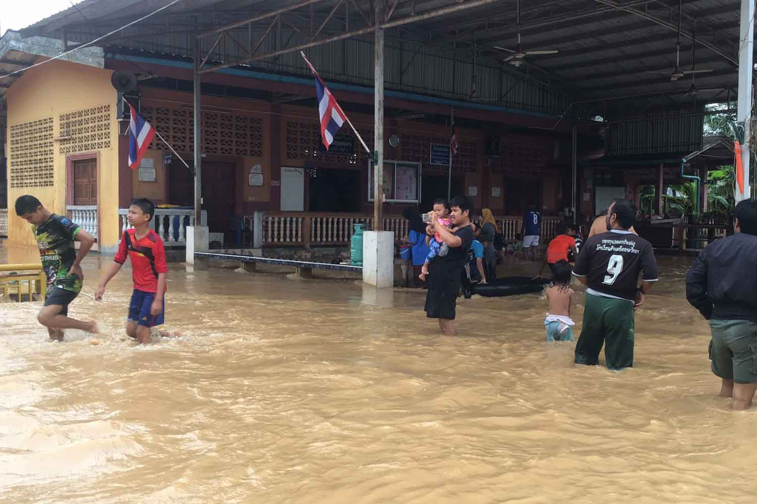 Nearly the entirety of Nam Lat village in Sadao district, Songkhla, is under water after being hit by a flash flood. (Photo by Assawin Pakkawan)