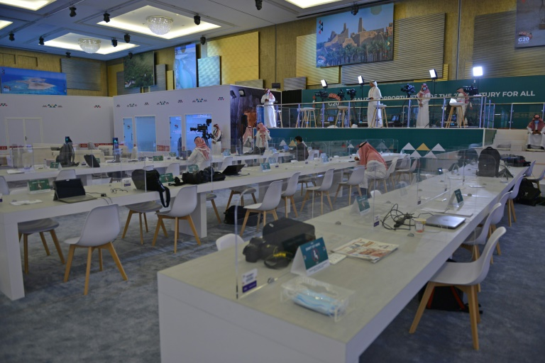 Journalists work in an almost empty media room set up for the coverage of the G20 summit, held virtually due to the coronavirus pandemic, in the Saudi capital Riyadh, on November 20, 2020.