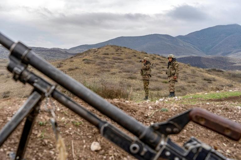 Armenian soldiers patrol a check point near a demarcation line outside Askeran