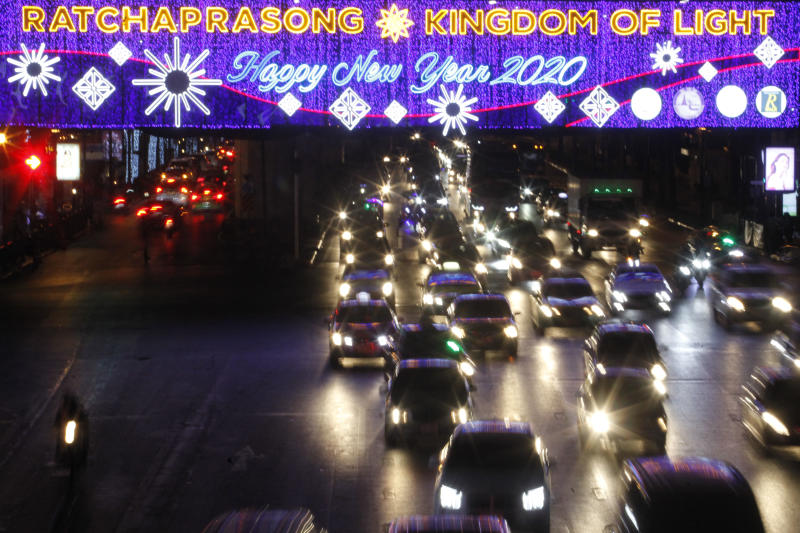 Happy New Year and Merry Christmas messages are displayed on an LED board at Ratchaprasong intersection last year. The Federation of Thai Industries predicts sluggish sales of festive items for the New Year holiday this year. (Photo by Wichan Charoenkiatpakul)