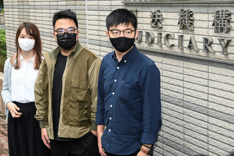 Activist Joshua Wong on Monday said he and two other prominent dissidents will plead guilty at a trial over their involvement in last year's protests.