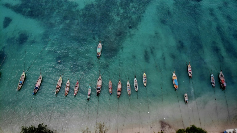 Pandemic respite for  'sea gypsies' threatened by mass tourism
