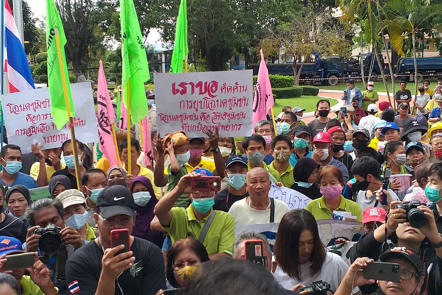 About 300 activists and land rights network members gather in front of the Phuket provincial hall to ask the government review a plan to scrap community land title deeds. (Photo: Achadtaya Chuenniran)