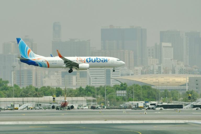 A flydubai Boing 737-800 lands at Dubai International Airport.