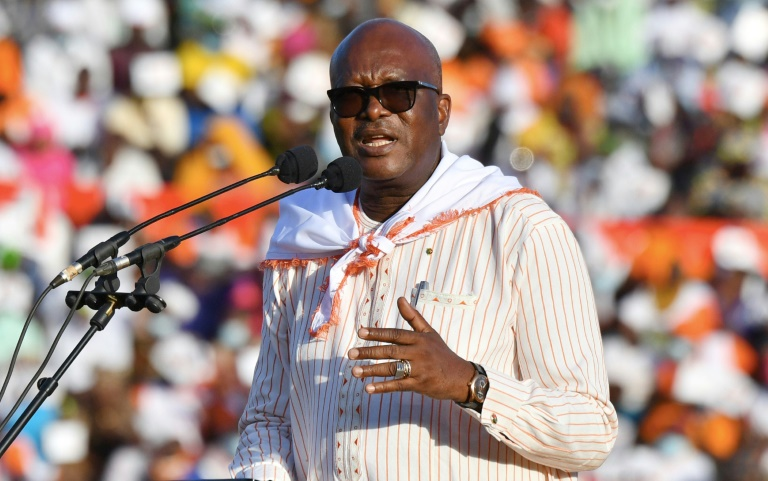 Burkina Faso's President Roch Marc Christian Kabore won re-election by gaining enough votes on Sunday to avoid a run-off