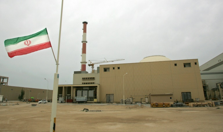 An Iranian flag flies outside the building housing the reactor of the Bushehr nuclear power plant in the southern Iranian port town of Bushehr. (AFP File Photo)
