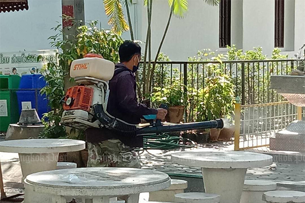 A worker sprays disinfectant in Muang district of Chiang Mai after a woman staying in the northern city had coronavirus. (Photo from Nakhon Chiang Mai Municipality Facebook account)