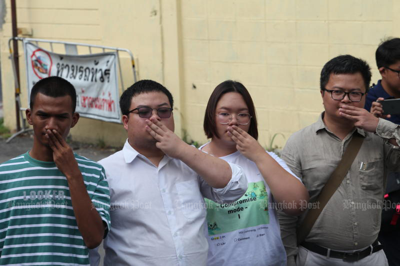 Protest leaders report to police, hear lese majeste charges