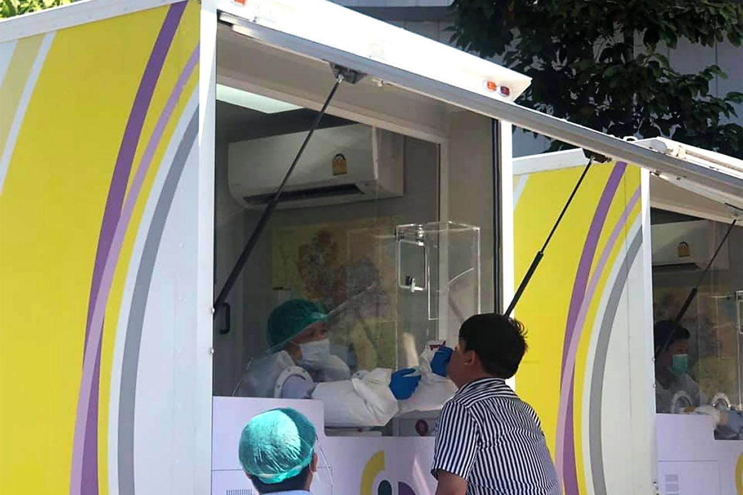 A Central Festival Chiang Mai worker receives a free Covid-19 test at a mobile unit.(Photo by the Public Relations office in Chiang Mai)