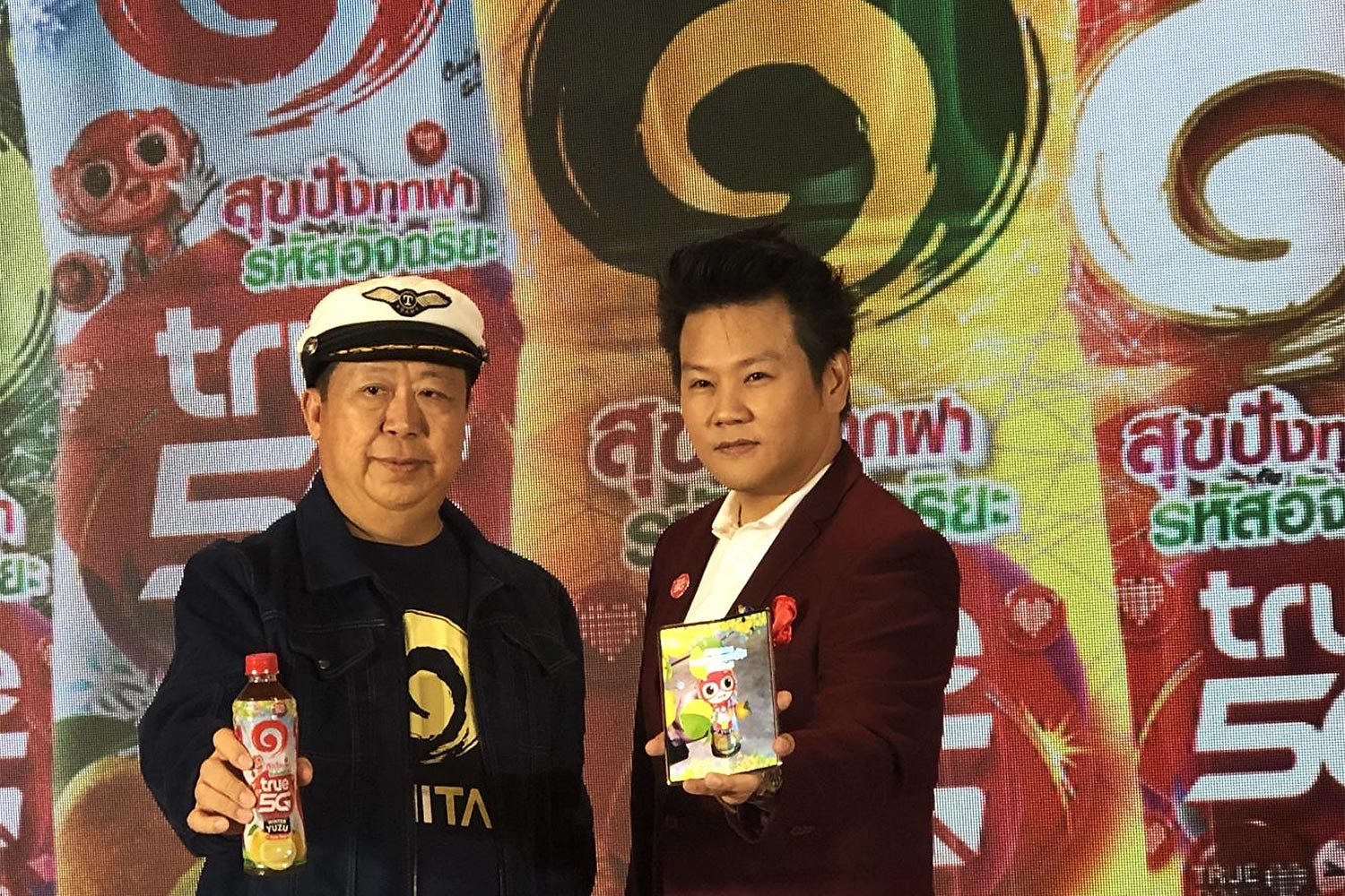 Mr Tan (left) with True's Oliver Kittipong Veerataecha launch a marketing campaign to tap into Thailand's green tea market.
