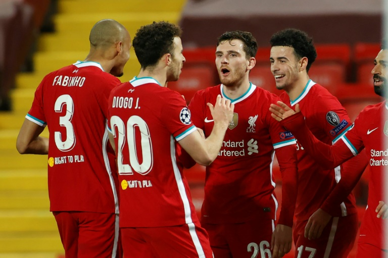 Liverpool advance in Champions League