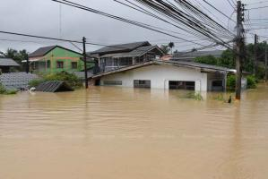 Flooding kills seven in South