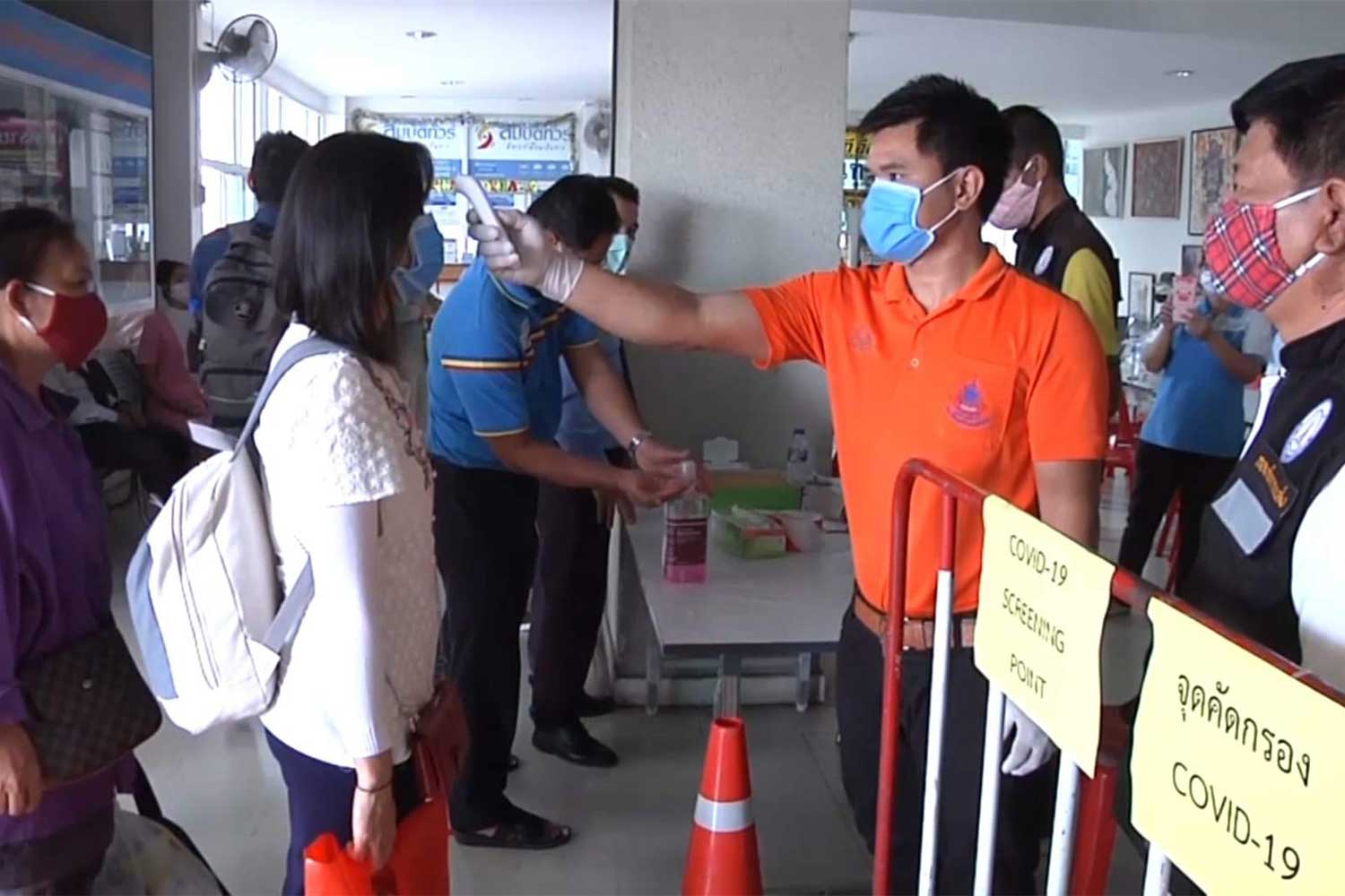 Passengers are checked by health staff at a bus terminal in Khon Kaen on Friday. (Photo by Chakkrapan Natanri)