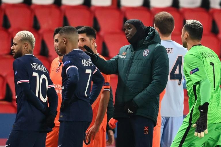 Istanbul Basaksehir forward Demba Ba remonstrates with officials as Paris Saint-Germain stars Neymar and Kylian Mbappe look on.