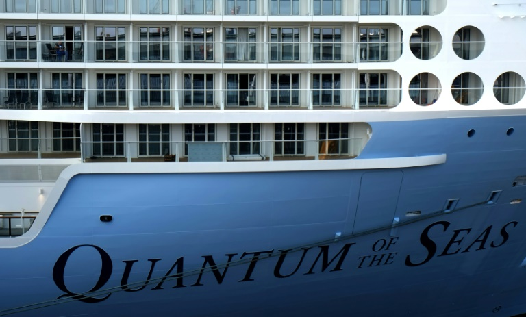 The Quantum of the Seas cruise ship turned back on day three of a four-day 'cruise to nowhere' after an 83-year-old passenger tested positive for the coronavirus.