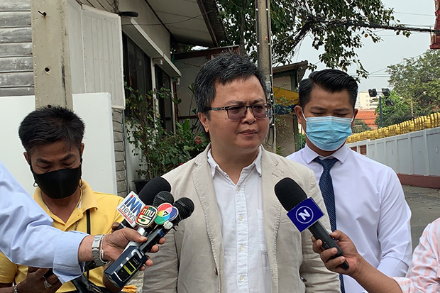 Lawyer Anon Nampa talks to reporters before reporting to Bang Pho police station on Monday. (Photo: Royal Thai Police)