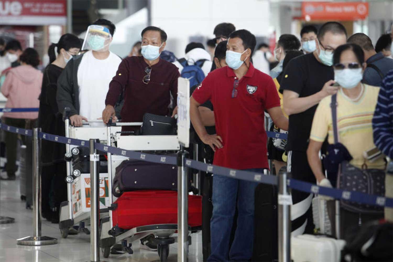 Thai and foreign passengers arrive at Suvarnabhumi airport in Samut Prakan province on Monday. (Photo by Wichan Charoenkiatpakul)
