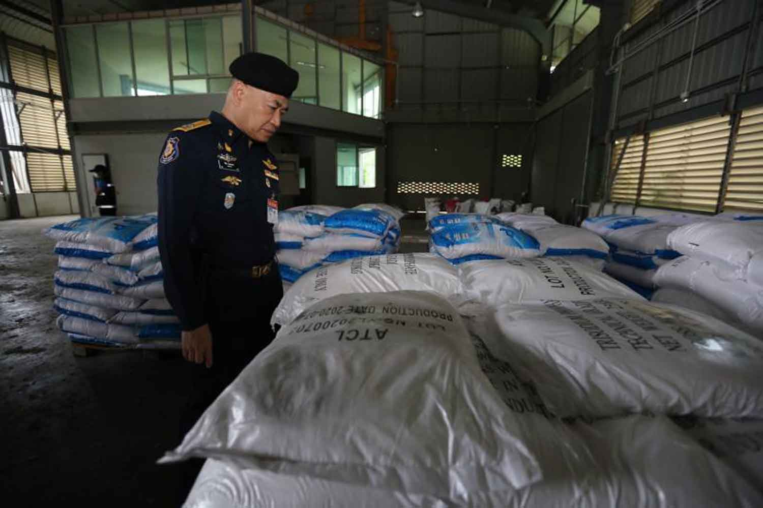 Wichai Chaimongkol, secretary-general of the Office of the Narcotics Control Board, inspects what turned out to be trisodium phosphate, in Chachoengsao province last month. (Police photo)