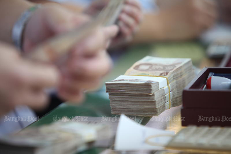 Thailand has been placed on a watch list of countries suspected of manipulating the baht against the greenback by the US Treasury. (Bangkok Post photo)