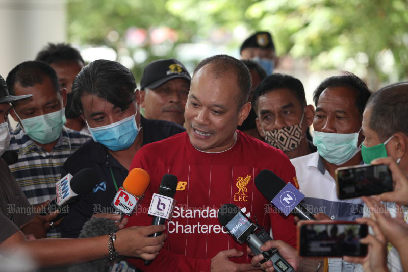 Nattawut Saikuar talks to reporters on June 26 this year before entering the Supreme Court to hear the final ruling on the violent protest outside the residence of late privy council president Prem Tinsulanonda in 2007. (Photo: Apichart Jinakul)