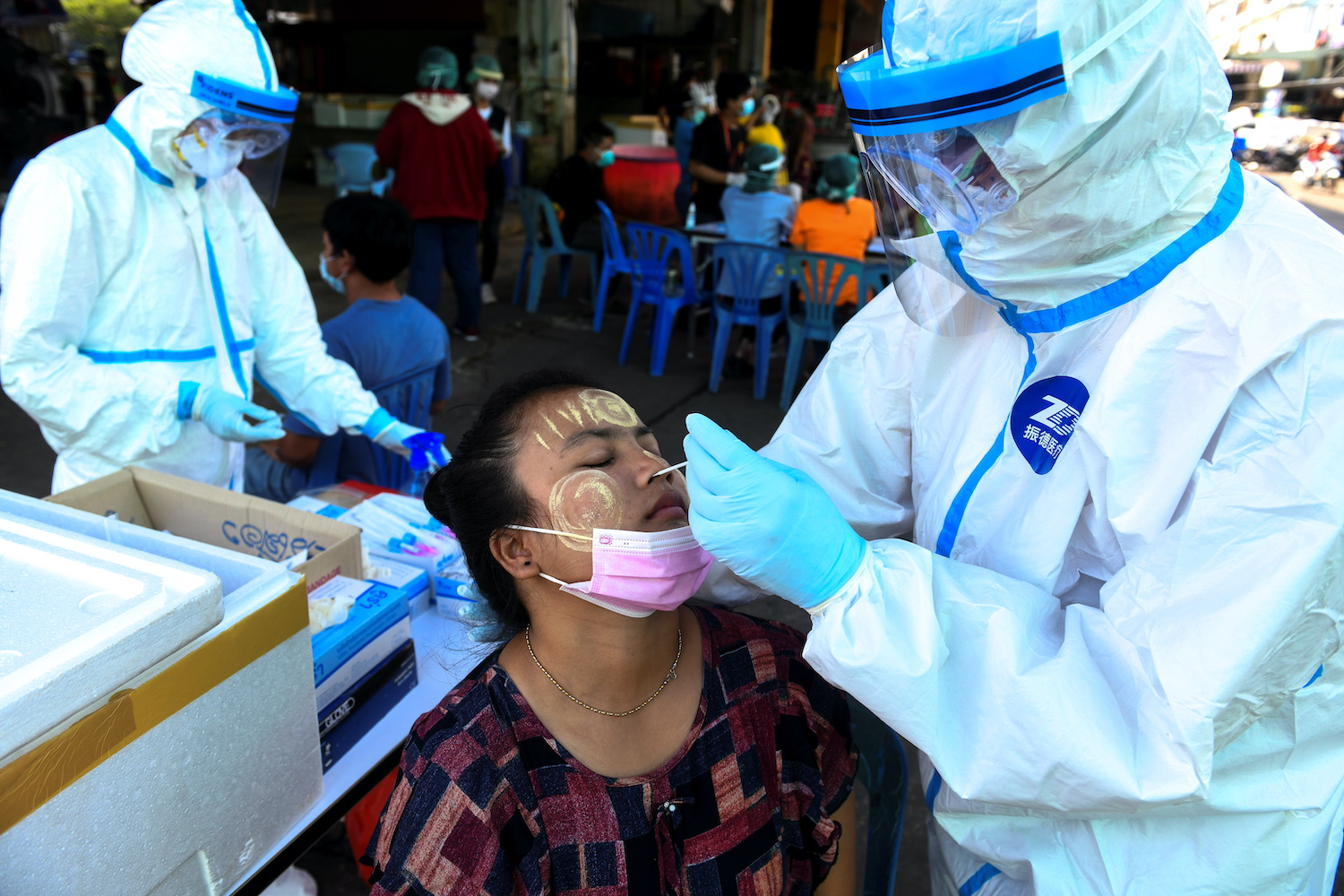 A medical worker takes a test swab from a migrant worker at a seafood market in Mahachai district of Samut Sakhon on Saturday. (Reuters Photo)