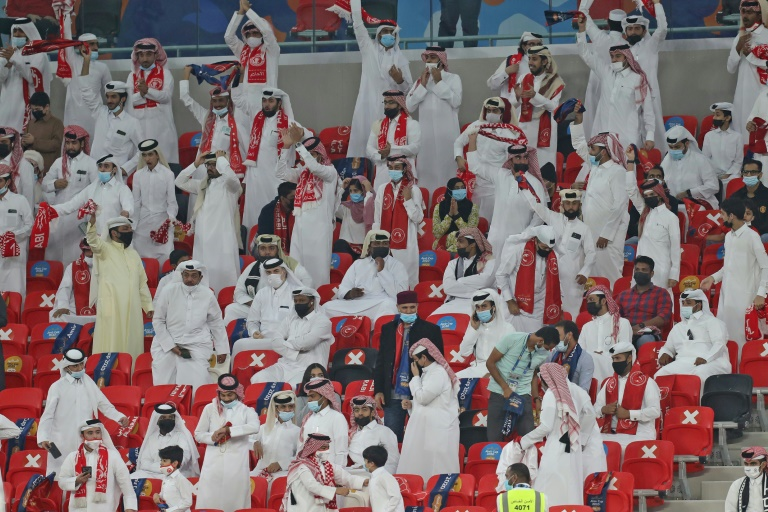 Mostly socially distanced fans watch a domestic cup final at the inauguration of Qatar's new Ahmad Bin Ali stadium, which will host World Cup 2022 matches.
