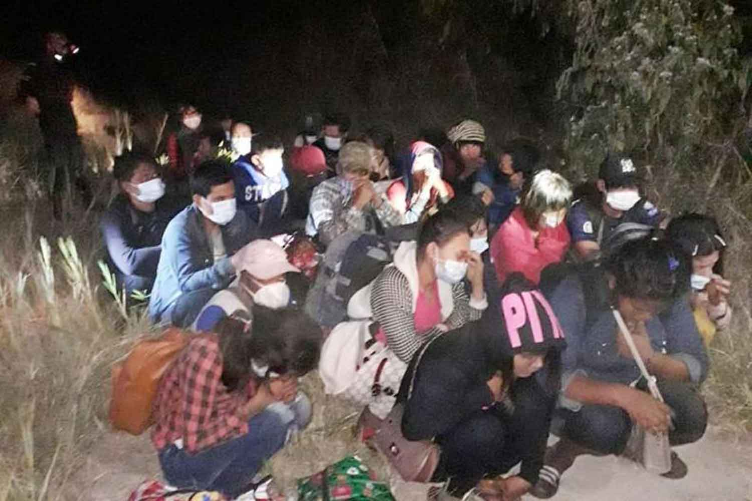 Twenty-five illegal migrants are arrested in Muang district of Kanchanaburi on Dec 12. (Photo: Piyarat Chongcharoen)