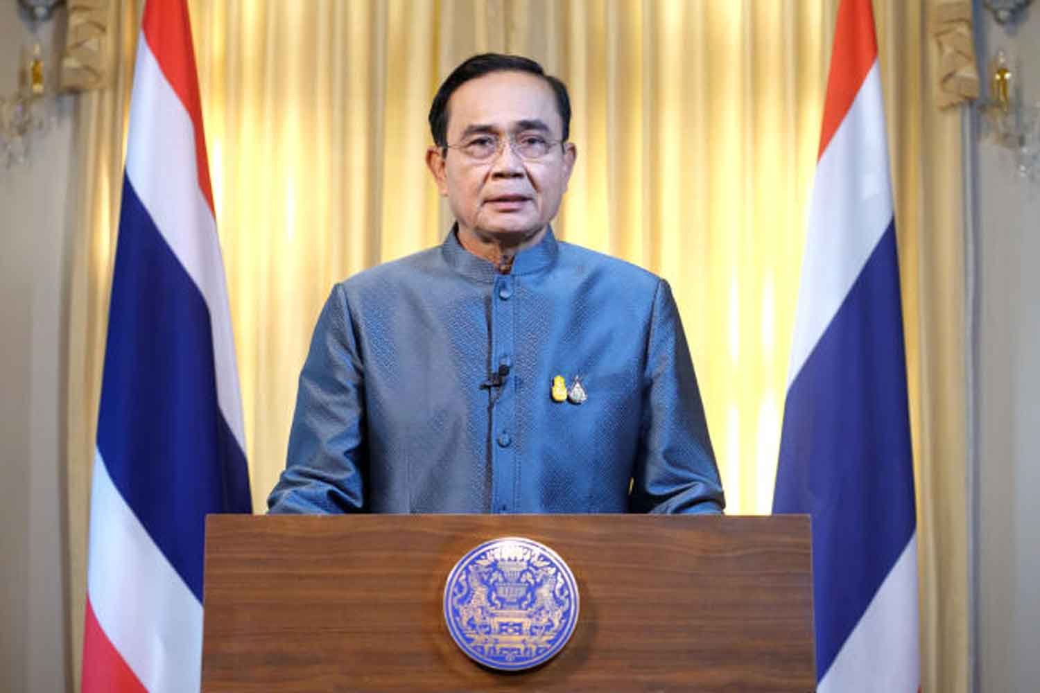 Prime Minister Prayut Chan-o-cha addresses the nation on the latest Covid-19 situations and impacts on Tuesday evening. (Government House photo)