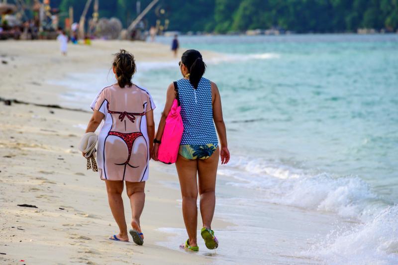 Tourists walk along a beach on Koh Lipe island in the Andaman sea on Dec 21, 2020. (AFP file photo)