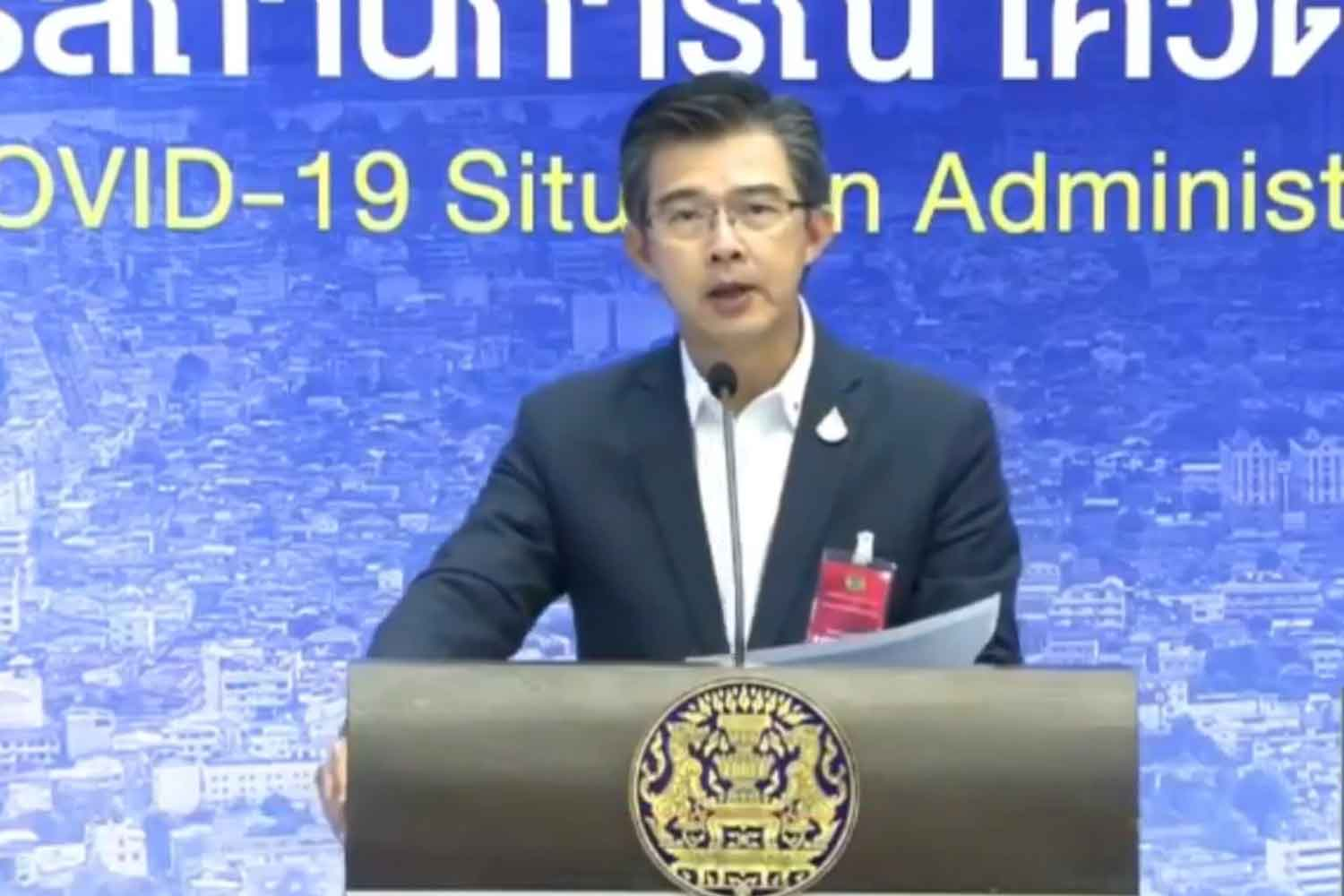 Dr Taweesilp Visanuyothin, spokesman for the Centre for Covid-19 Situation Administration, announces nationwide tiered gathering bans at Government House in Bangkok on Wednesday. (Screenshot from Covid-19 Information Centre Facebook page)