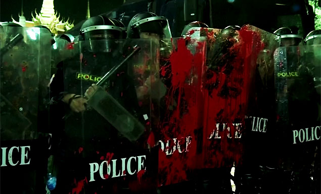 Protesters hurl paint, firecrackers at police
