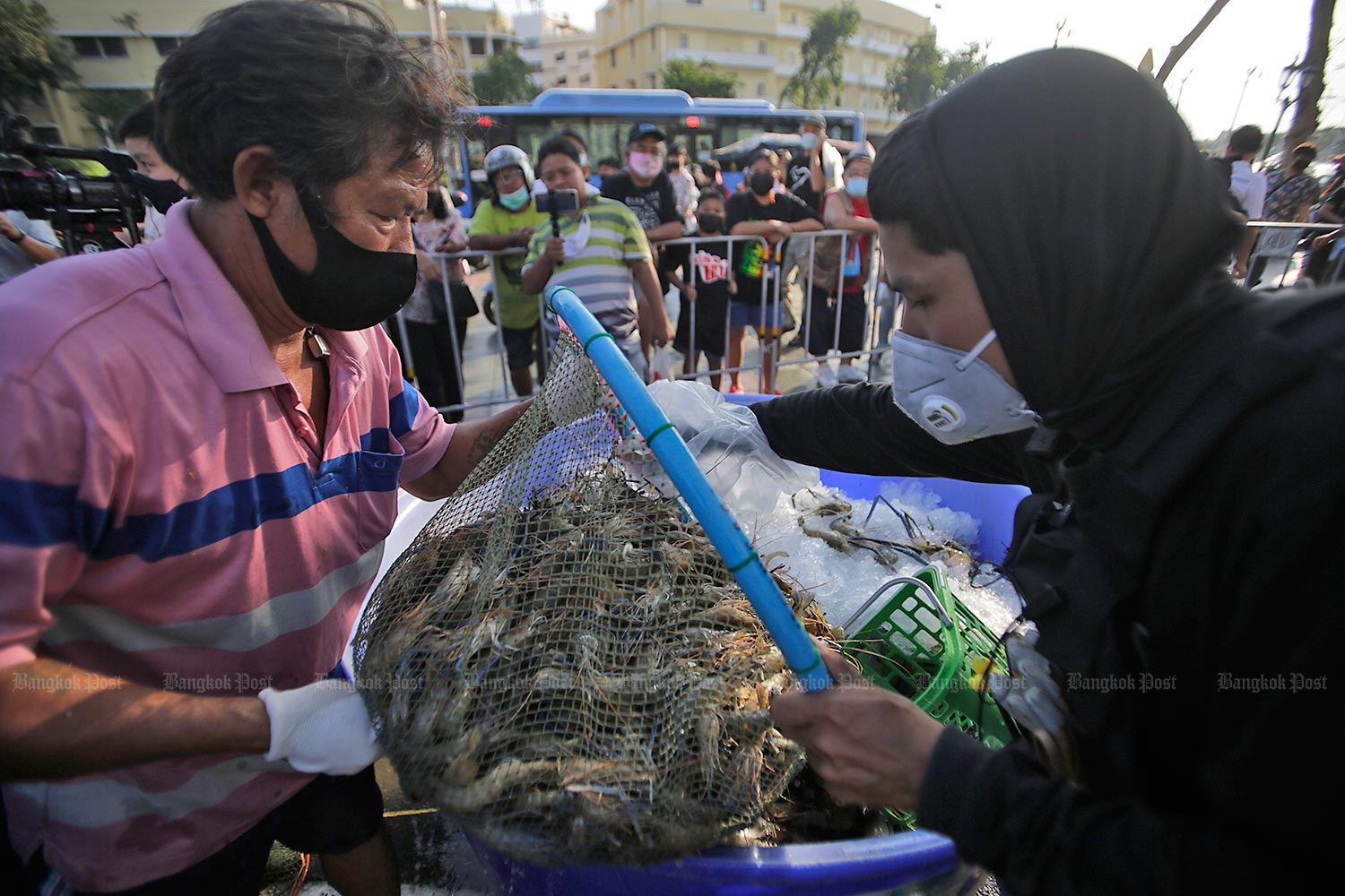 Vendors hawk prawns at a makeshift market organised by anti-government protesters at Kok Wua intersection in Bangkok on Thursday. The stalls were initially set up at the nearby Sanam Luang, but moved to the intersection after pressure from authorities.(Photo by Pornprom Satrabhaya)