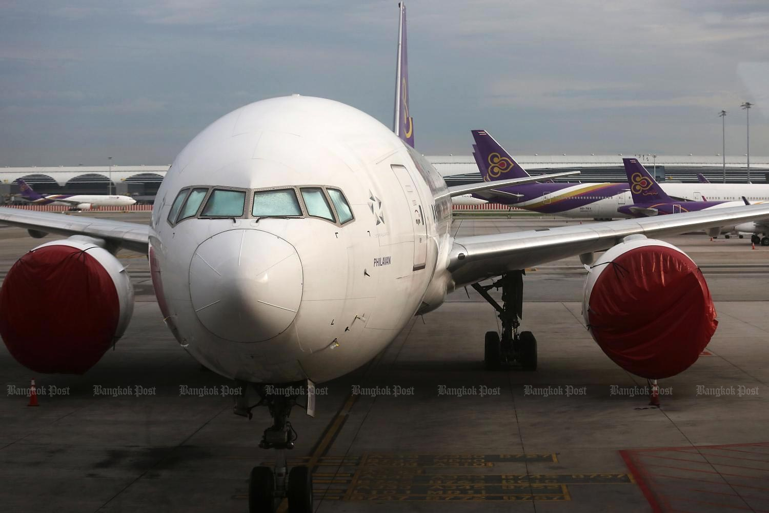 Thai Airways airplanes are seen parked on the tarmac at Suvarnabhumi airport. The Central Bankruptcy Court heard in July the rehabilitation plan of the loss-ridden carrier, which has been further battered by the impact of Covid-19. (Photo by Wichan Charoenkiatpakul)