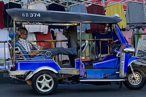A tuk tuk driver waits for passengers near the famous walking street in Muang district of Chiang Mai province on Dec 28, 2020. (Photo by Saritdet Marukatat)