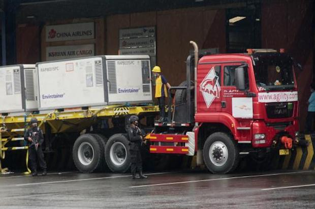 A lorry transports containers carrying the second batch of Covid-19 vaccines made by Sinovac, upon its arrival from Beijing at the Jakarta International Airport in Tangerang on Dec 31, 2020. (AFP photo)