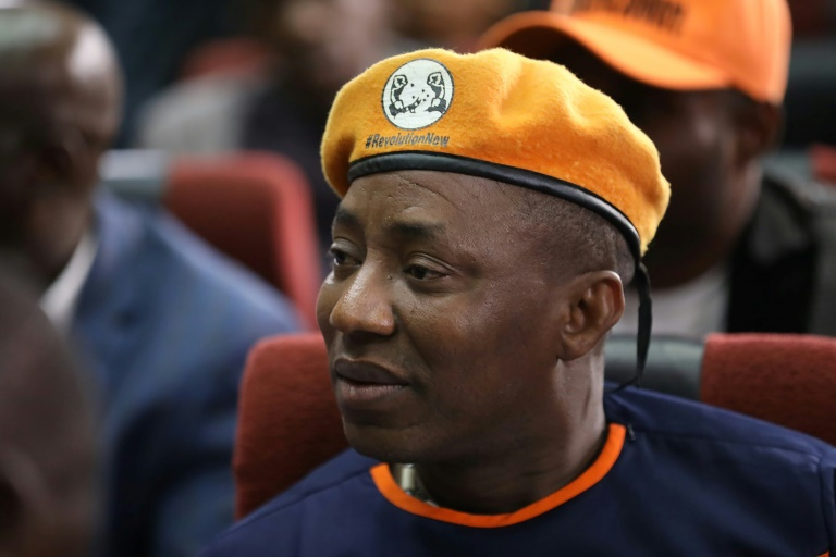 Police who arrested Nigerian opposition leader Omoyele Sowore - here in February 2020 -