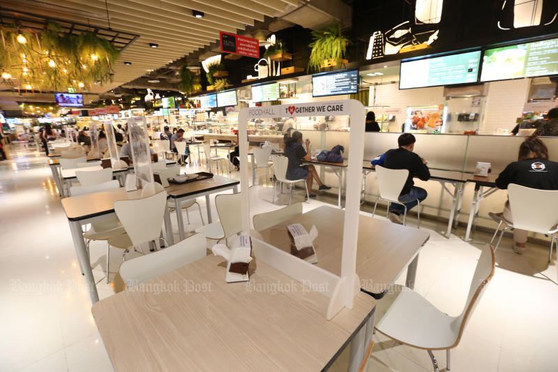 This food court at The Mall Bang Kapi shopping centre had carefully distanced seating on Monday, in line with regulations issued by the Bangkok Metropolitan Adminsitration to stem the spread of Covid-19 in the capital. (Photo: Varuth Hirunyatheb)