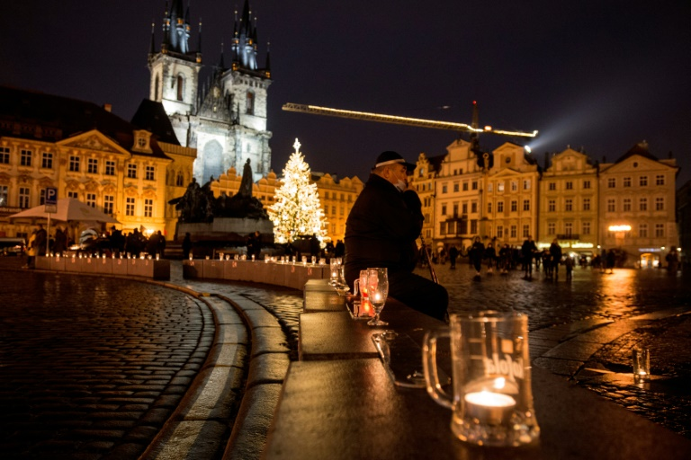 Beer glasses with candles were placed in the Old town Square in Prague during the protest over virus restrictions.