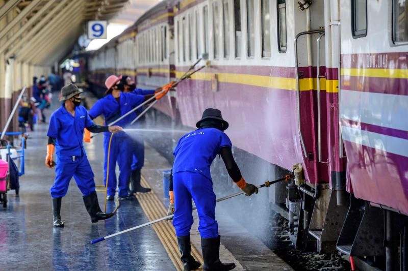 Employees clean and disinfect a train at Hua Lamphong Central Railway Station in Bangkok on Monday after health officials announced 745 new Covid-19 coronavirus cases, the country's highest daily figure since the start of the pandemic. (AFP photo)