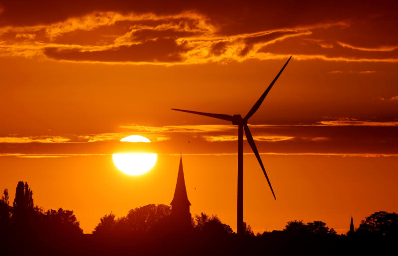 FILE PHOTO: A power-generating windmill turbine is pictured during sunset at a renewable energy park in Ecoust-Saint-Mein, France, Sept 6, 2020.  analysts say renewable energy stocks in Asia could surge in 2021. (Reuters)