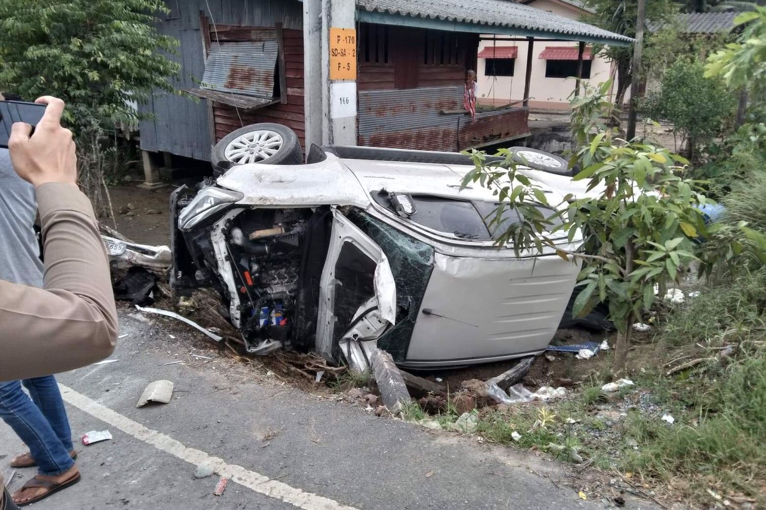The wreckage of one the pickup trucks in a crash that took place in Hau Sai district, Nakhon Si Thammarat province, on Monday. A man was killed instantly and two others were injured, one seriously. (Photo by Suchet Raekrun)