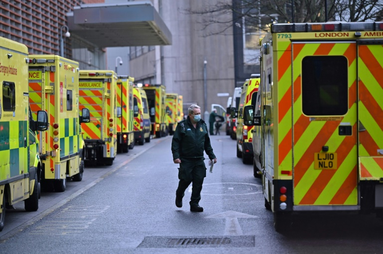 A paramedic is seen by a line of ambulances outside the Royal London Hospital as England begins a six-week lockdown.