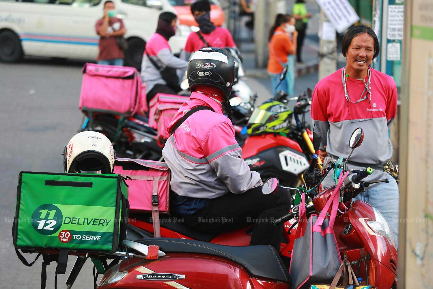 Online food delivery drivers have seen increased food delivery orders amid the surge in Covid-19 cases across the country.(Photo by Somchai Poomlard)