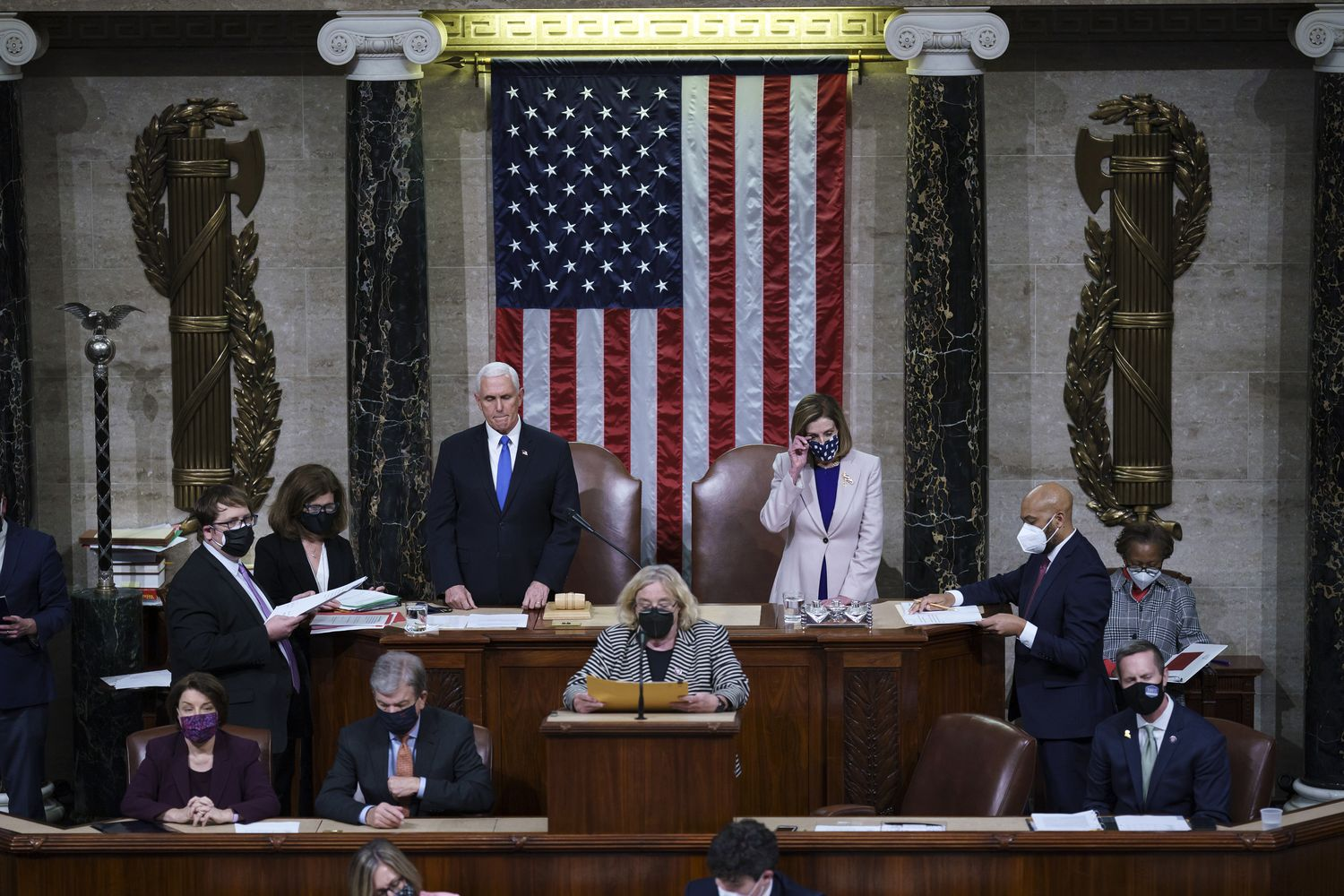 US Vice President Mike Pence (left) and US House Speaker Nancy Pelosi, a Democrat from California, during a joint session of Congress to count the Electoral College votes of the 2020 presidential election in the House Chamber in Washington DC on Thursday. Joe Biden was formally recognised by Congress as the next US president early Thursday, ending two months of failed challenges by his predecessor, Donald Trump, that exploded into violence at the US Capitol as lawmakers met to ratify the election result. (Photo by AP/Bloomberg)