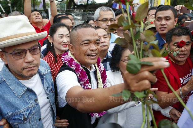Jatuporn Prompan receives flowers from his supporters after being released from Bangkok Remand Prison on Aug 4, 2020. (Photo by Pattarapong Chatpattarasill)