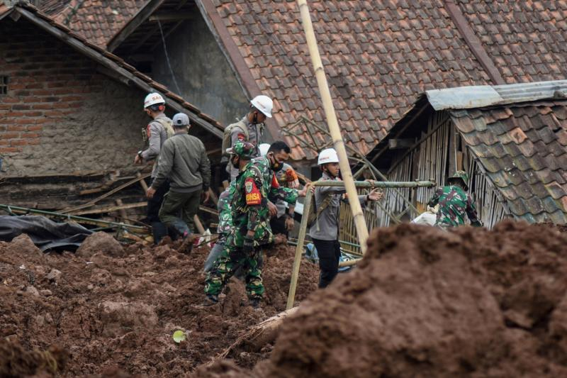 Rescuers search for survivors after two landslides killed at least 11 people, including a six-year-old boy, with scores more missing in Sumedang, West Java province on Sunday. (AFP photo)