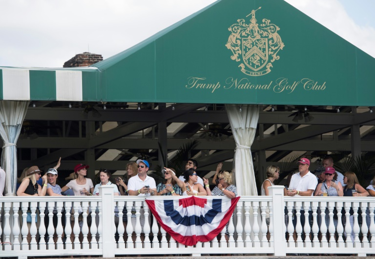 In this file photo taken on July 16, 2017, people watch as US President Donald Trump arrives at the 72nd US Women's Open Golf Championship at Trump National Golf Course in Bedminster, New Jersey